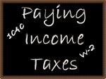 Paying Income Taxes on chalk board