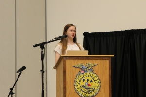 2017 Money Smart Kid, Kira Currier, reads her winning essay to conference attendees.